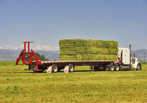 Stinger Inc | Homepage, big bale stacker, bale wagons, cube line